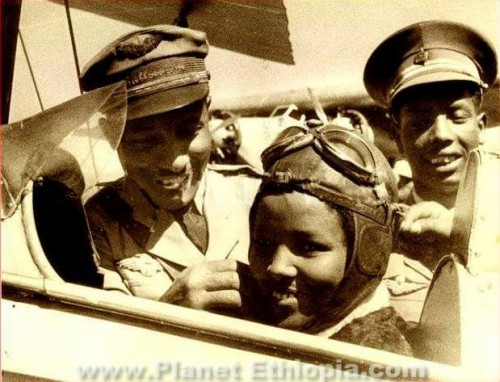 "Africa's first female pilot was Muluemebet Emiru from Ethiopia. Muluemebet started training in 1934 or 1926 (Ethiopian calendar) – completing the course in 1936. Her piloting career though was cut short by the Italian invasion of May 1936. She was also Ethiopia's first licensed female driver in 1934.  ""I was overwhelmed. It was a tremendous thrill though I did not realize at the time… that I was Africa's first woman pilot. But with the war, I gave up flying. Indeed I got married."", the 1980 Selamta, the in-flight magazine of Ethiopian Airlines quotes Muluemebet as saying. ""I would fly several times a week – always over Addis. It was an unusual experience and my friends all envied me.""  Muluemebet trained alongside six other Ethiopian students who trained on a French model and an English Tiger Moth planes. It is believed that its these students who led to the birth of current Ethiopian Airlines."