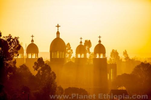 EthiopianOrthodoxchurchbacklitbymorningsunraysinAddisAbabaEthiopia1.jpg