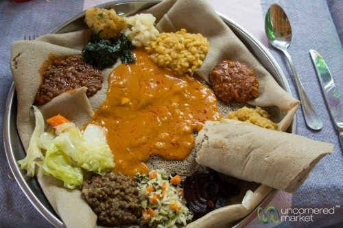Ethiopian cuisine (Amharic: የኢትዮጵያ ምግብ) characteristically consists of vegetable and often very spicy meat dishes. This is usually in the form of wat, a thick stew, served atop injera, a large sourdough flatbread,[1] which is about 50 centimeters (20 inches) in diameter and made out of fermented teff flour.[1] Ethiopians eat exclusively with their right hands, using pieces of injera to pick up bites of entrées and side dishes.[1] Utensils are optional.  The Ethiopian Orthodox Church prescribes a number of fasting (tsom, Ge'ez: ጾም ṣōm) periods, including Wednesdays, Fridays, and the entire Lenten season, so Ethiopian cuisine contains many dishes that are vegan
