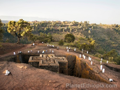 Lalibela  ላሊበላ?  is a town in Amhara Region, northern Ethiopia famous for monolithic rock-cut churches. The whole of Lalibela offers an exceptional testimony to the medieval and post-medieval civilization of Ethiopia.[1] Lalibela is one of Ethiopia's holiest cities, second only to Aksum, and a center of pilgrimage. Unlike Aksum, the population of Lalibela is almost completely Ethiopian Orthodox Christian. Ethiopia is one of the earliest nations to adopt Christianity in the first half of the fourth century, and its historical roots date to the time of the Apostles.  The layout and names of the major buildings in Lalibela are widely accepted, especially by local clergy, to be a symbolic representation of Jerusalem.[2] This has led some experts to date the current church forms to the years following the capture of Jerusalem in 1187 by Muslim leader, Saladin.[3]  Lalibela is located in the Semien Wollo Zone of the Amhara Region, at roughly 2,500 meters above sea level. It is the main town in Lasta woreda, which was formerly part of Bugna woreda. The Rock-Hewn Churches were declared a UNESCO World Heritage Site in 1978. Source: Wikipedia