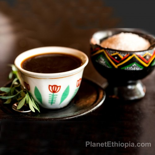 A coffee ceremony (Amharic: ቡና ማፍላት, translit. buna maflat) is a ritualised form of making and drinking coffee. The coffee ceremony is one of the most recognizable parts of Ethiopian culture and Eritrean culture. Coffee is offered when visiting friends, during festivities, or as a daily staple of life. If coffee is politely declined then most likely tea (shai) will be served. The host pours the coffee for all participants by moving the tilted boiling pot over a tray with small, handleless cups from a height of one foot without stop until each cup is full.[3] The grounds are brewed three times: the first round of coffee is called awel in Tigrinya, the second kale'i and the third baraka ('to be blessed').[4] The coffee ceremony may also include burning of various traditional incense.[4] People add sugar to their coffee, or in the countryside, sometimes salt or traditional butter (see niter kibbeh).[3] The beverage is accompanied by a small snack such as popcorn, peanuts or himbasha. Source: Wikipedia