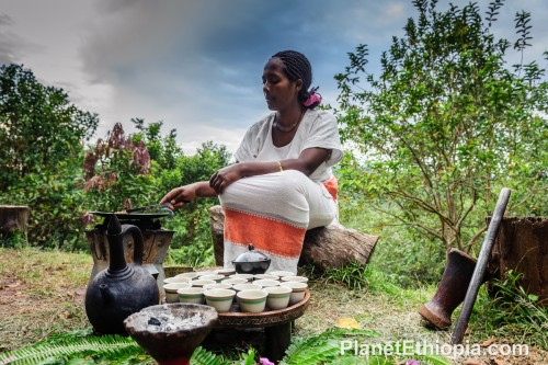 A coffee ceremony (Amharic: ቡና ማፍላት, translit. buna maflat) is a ritualized form of making and drinking coffee. The coffee ceremony was first practiced in Ethiopia and became part of Eritrean culture as Eritrea was once part of Ethiopian . There is a routine of serving coffee on daily basis mainly for the purpose of getting together and having a little talk with relatives , neighbors and etc. If coffee is politely declined then most likely tea (shai) will be served. The ceremony is typically performed by the woman of the household and is considered an honor.[1] The coffee is brewed by first roasting the green coffee beans over an open flame in a pan .[2][3] This is followed by the grinding of the beans, traditionally in a wooden mortar and pestle.[3] The coffee grounds are then put into a special vessel which contain boiled water and will be left on an open flame a couple of minutes until it is well mixed with the hot water.[2] After grinding, the coffee is put through a sieve several times.[3] The boiling pot (jebena) is usually made of pottery and has a spherical base, a neck and pouring spout, and a handle where the neck connects with the base.[3] The jebena also has a straw lid.  Source: Wikipedia